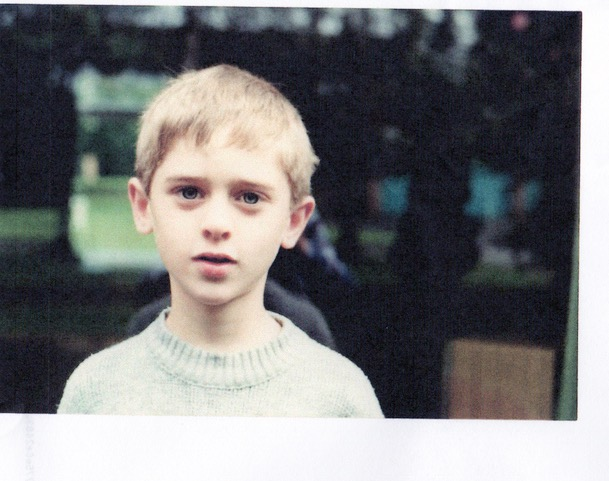A photograph of Christopher Rozruch as a boy, aged around 9. It is taken in Stourbridge in the British West midlands.